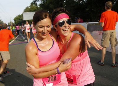 Caro and I made the Charlottesville newspaper!! Emotional finish - running for Debbie and Tammy.  (photo curtesy of The Daily Progress)